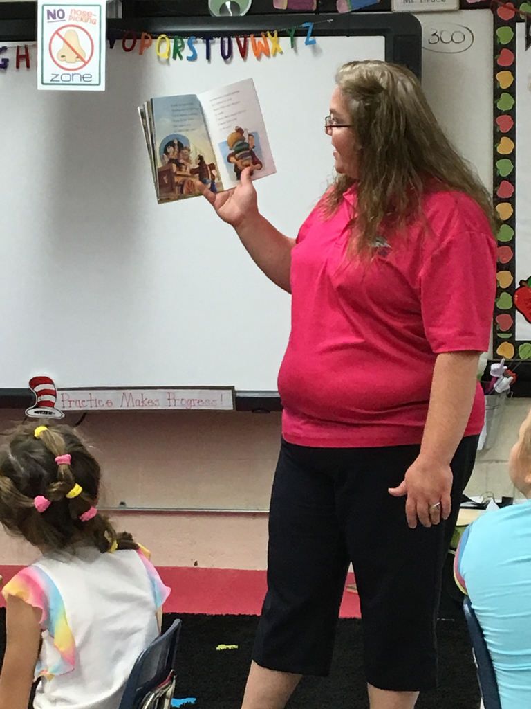 Mrs. Roberts reading a story about Johnny Appleseed