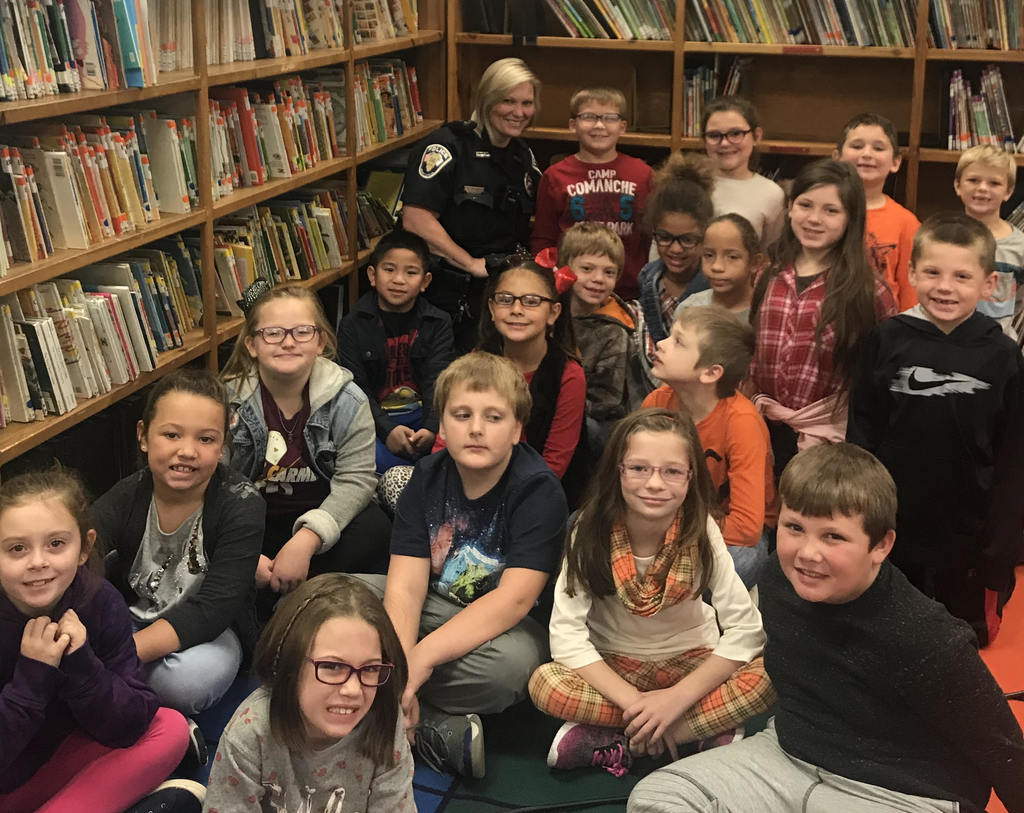 Officer Peach pictured with Ms. Bruce's Class